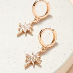 gold tone northern star hoop earrings rhinestones